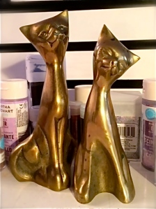 Unfortunately, these golden cats I from the thrift store did nothing to enhance my popularity.  Here they await their glitter makeover.